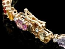 Lot 23: 14K Gold 13.03ct Sapphire 0.52ct Diamond Bracelet