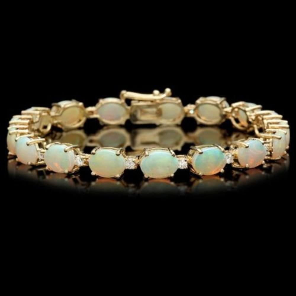 Lot 59: 14k Gold 15.13ct Opal 0.79ct Diamond Bracelet