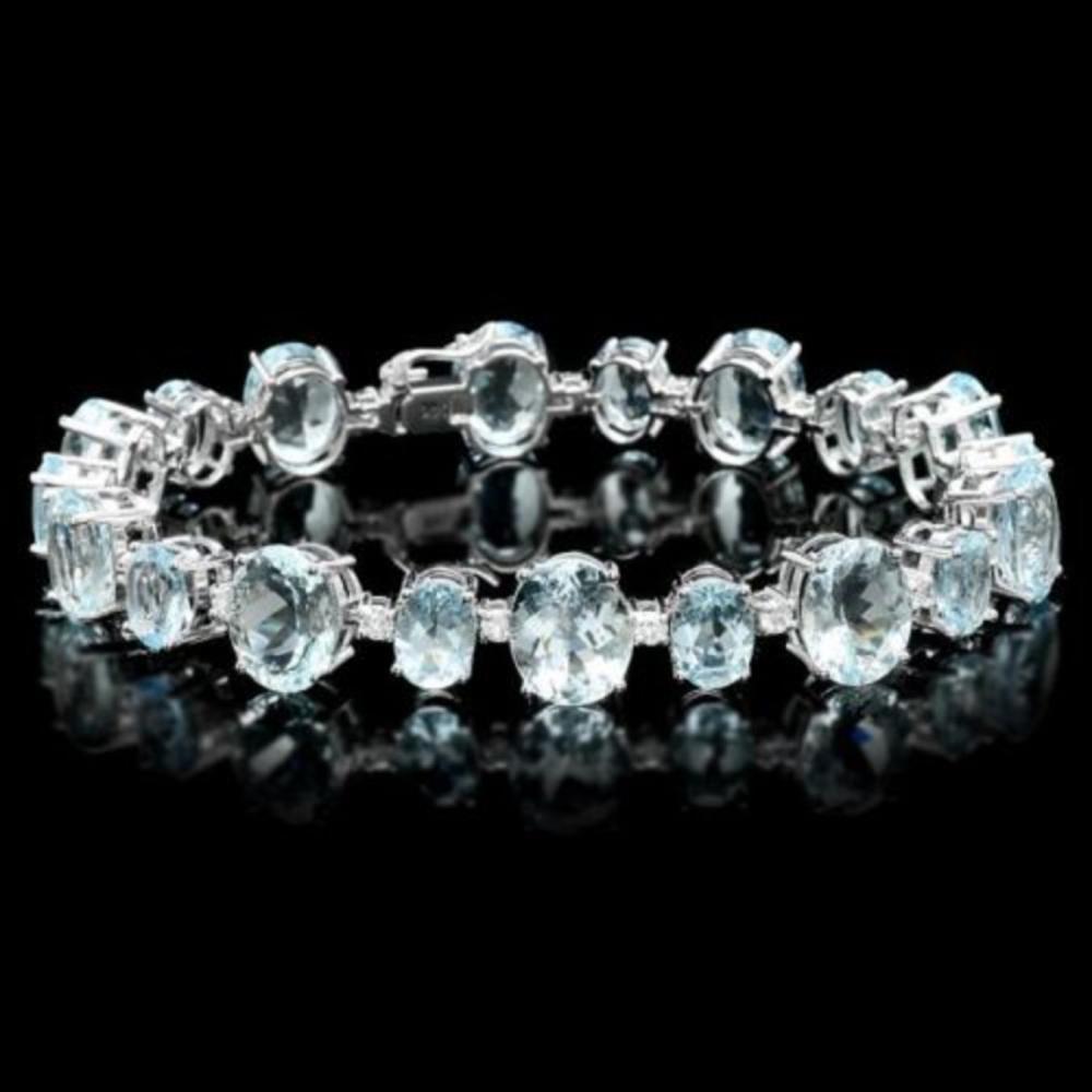 Lot 75: 14K Gold 39.22ct Aquamarine 1.29ct Diamond Bracelet