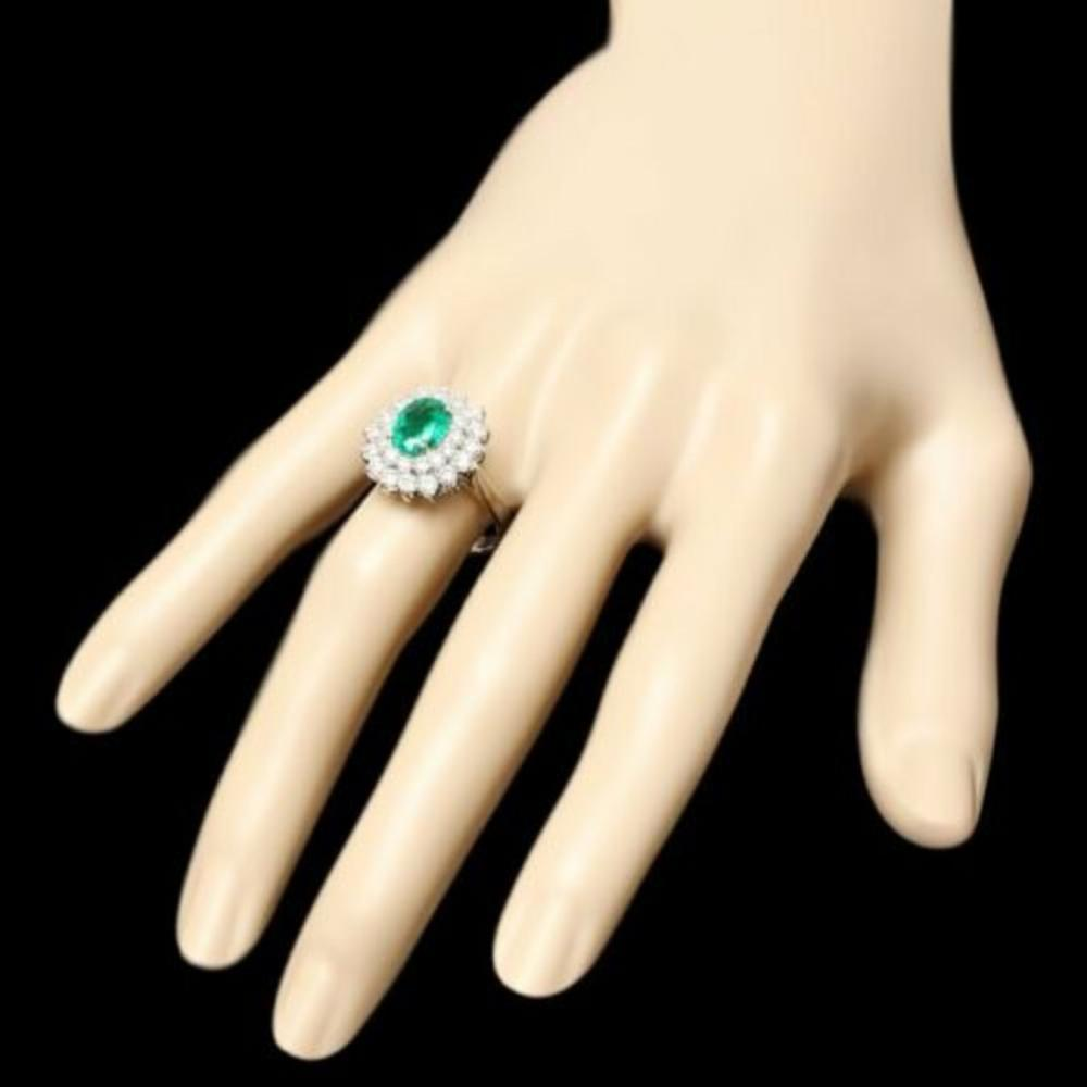 Lot 15: 14K White Gold 1.47ct Emerald and 1.32ct Diamond Ring