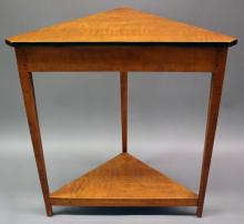 """Furniture: RC – reproduction tiger maple corner stand/table, likely David  Smith Co. but unmarked, three tapered legs with triangular top and base  shelf bottom, 32""""W X 34 ¼""""T X 18""""D (VG) PICK UP ONLY"""