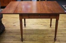 """Furniture: RC – see also #240 chairs – reproduction solid cherry four-leg  side extension table, Sheraton style, on turned legs with one dovetailed  drawer, comes with one side extension leaf, 40"""" square X 30""""T – 40"""" X 50""""  with extension in (VG)  PICK UP ONLY"""