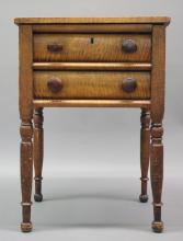 """Furniture: from the Jean Smith Campbell Estate: a period Sheraton tiger   maple stand/work table, two-drawer (one with hidden bottom spring lock),    shows signs of wear, top warped, 21""""W X 16 ¾""""D X 29 ¾""""T  (FAIR/STAINS/LOSS @KNOBS & ONE LEG TOP WARPED)   PICK UP  ONLY"""