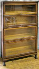 """Furniture: CE – oak stack bookcase, four-section glass door barrister on paw foot base, in original finish, 34 ¼""""W X 12 ½""""D X 55 ½""""T (VG/ LIGHT WEAR/MARKS) PICK UP ONLY"""