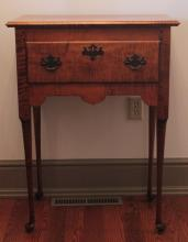 """Furniture: RC – a very good and fine reproduction Queen Anne style one- drawer work table/stand marked for 'J.L. Treharn Co. Inc Youngstown OH'  with beaded overlapping single drawer over an acorn cut out @apron with  brass bail pulls on fine Queen Anne legs/feet, 25 ¾""""W X 34 ½""""T X 15  ½""""D (VG)  PICK UP ONLY"""