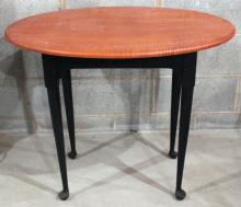 """Furniture: RC – a clean tiger maple oval top lamp table marked for David  Smith Co. with painted black over red Queen Anne style base, 22 ½""""D X  32 ½""""W X 26 ½""""T (VG)  PICK UP ONLY"""