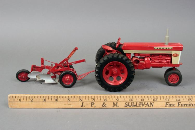 Lot 210 Tractor Farmall 560 With IH McCormick 2 Bottom Plows Pull Type VG