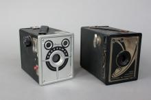 Two Cameras (Ansco) * * Ansco Craftsman Art-Deco style View Camera (1951) 120mm. | Body Serial #: N/A | Lens Serial #: N/A | Condition: Average * Ansco 120 View Camera (World's Fair 1933) Art Deco, wooden construction Camera 120mm Roll Film View Finder w/ built-in w/ filter N/A. | Body Serial #: N/A | Lens Serial #: N/A | Condition: Fair (Viewfinder glass is cracked)