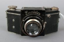 Exacta A Camera 127mm Rangefinder (Germany) all black w/ Carl Zeiss Jena Tessar 7.5cm F/2.8 w/ leather case. | Body Serial #: 410306-414465 | Lens Serial #: 1607756 | Condition: Poor (shutter doesn't trip)