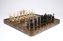 A fine Chinese lacquer chess and backgammon board with ivory game pieces, 19th C.