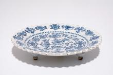 A German blue and white lobed plate on three feet, Nürnberg, 17th C.