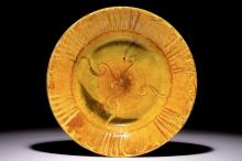Alfred William Finch (1854 –1930): A large yellow-glazed slip-decorated ceramic dish
