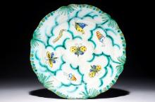 A Brussels faience plate with butterflies and caterpillars, 18/19th C.