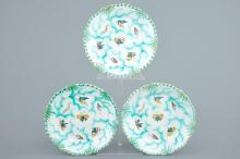 Three Brussels faience plates with butterflies and caterpillars, 18/19th C.