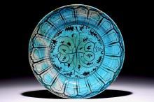 An Islamic turquoise and black Kubachi dish, Iran, 17th C.
