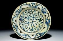 An Iznik pottery dish with blue and black design, Turkey, 17th C.