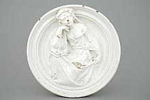 An Italian white glazed pottery relief medallion after Della Robbia, 17th C