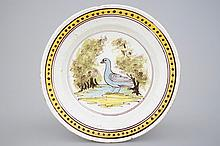 A Brussels faience dish with a bird 18th C., Dia.: 29, 5 cm