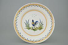 A polychrome Brussels faience plate with a cockerel 18th C., Dia.: 31, 5 cm