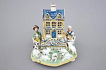 A rare French pottery group with musicians herding sheep by a house 18th C.