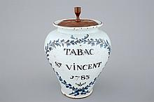 A small tobacco jar with wooden cover North of France 18th C., H.: 21 cm