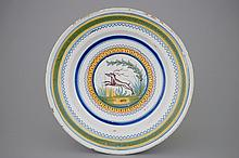 A polychrome Brussels faience dish with a deer 18th C., Dia.: 31 cm