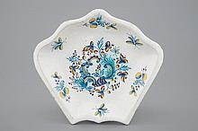 A Brussels faience plate part of a rice table dish 18th C., Dim.: 24 x 22