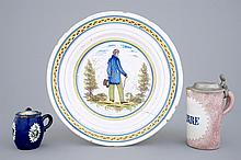 A Brussels faience dish a beer stein and a mustard jar 18th C., Dia.: 32