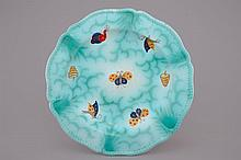 A Brussels faience dish with butterflies and caterpillars 19th C., Dia.: 33