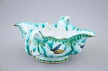 A Brussels faience sauce boat with butterflies and caterpillars 18th C., Di