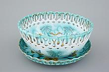A Brussels faience basket on stand with butterflies and caterpillars 18th