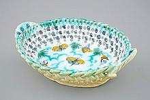A Brussels faience basket with butterflies and caterpillars 18th C., Dim.: