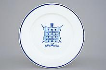 A Tournai porcelain plate with the arms of St.-Sebastian's Archers Guild an