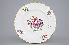 A polychrome Tournai porcelain plate with floral decoration 18th C., Dia.:
