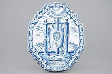 A blue and white plaque with  The Passion of Christ  Makkum Friesland 1