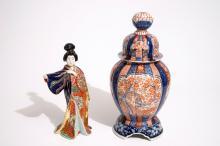 A Japanese Imari vase on stand and a Kutani model of a bijin, Meiji, 19th C.