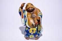 A large Japanese Kutani figure of Buddha Hotei, Meiji, 19th C.