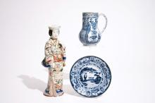 A blue and white Arita jug and a plate, 17/18th C., with an Imari figure, 18/19th C.
