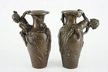 After Auguste Moreau (1834-1917)  A pair of bronze Art Nouveau vases  19/20th C.