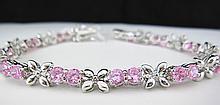 Round Pink Sapphire, White Gold Tennis Bracelet.