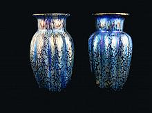 Pair of art glass blue Loetz vases.