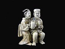 Carved oriental Ivory Netsuke of a man & woman