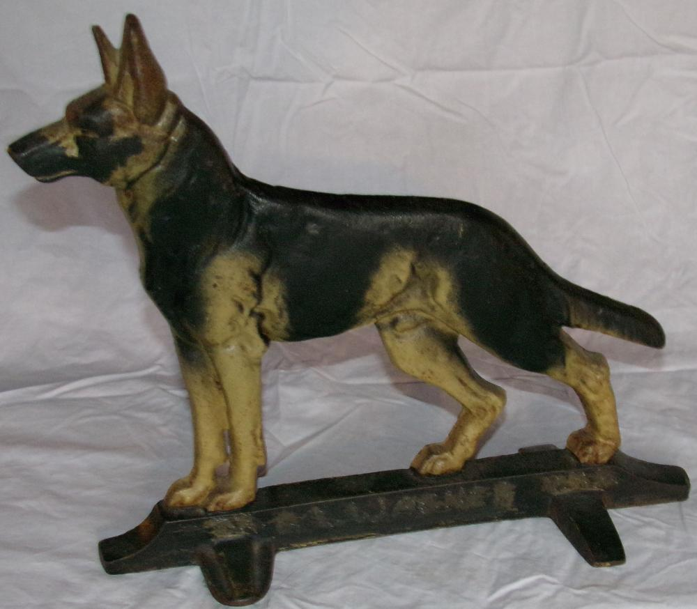 "Vintage cast iron German Shepherd dog form doorstop on rectangular base, painted, name scratched into base is not original, 11 ¾"" T x 13 1/8''W x 5 1/8"" D"