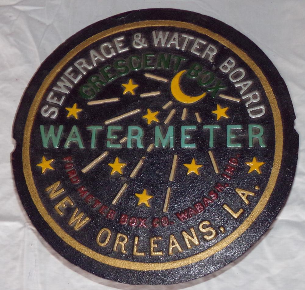"Vintage cast iron water main lid, marked Ford Meter Box Co. Wabash, Ind. Sewerage and Water Board, Water Meter, New Orleans La., paint decorated, foundry mark reads NOL, 2 ½"" T x 11 ¾"" D"
