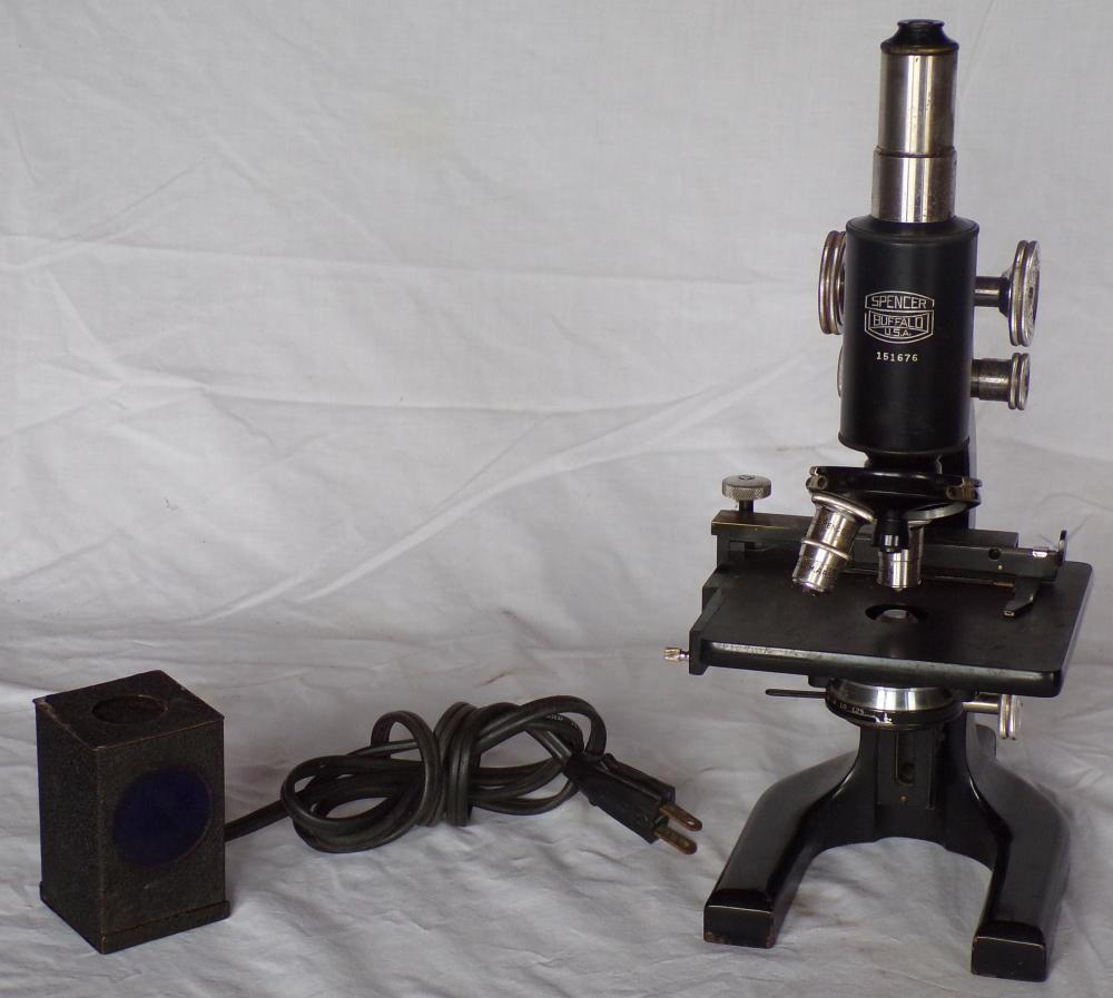 "Scientific microscope by Spencer, Buffalo USA with 6 lenses, accessories & black case, SN # 151676;microscope - 12 3/4"" T, case -10"" T x 14 ¼"" W x 8 ¼"" D, some paint loss & rust on microscope, case shows soiling,"