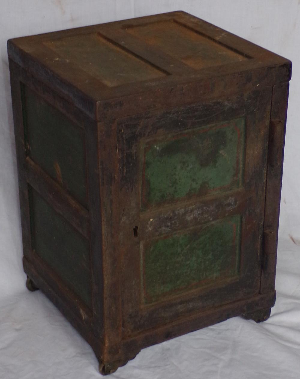 "Antique miniature cast iron safe, case with remnants of old green paint & red striping ending on casters, wooden interior with pigeon holes, key lock, No Key, 13 1/8"" T x 9 1/8"" W x 8 7/8"" D"