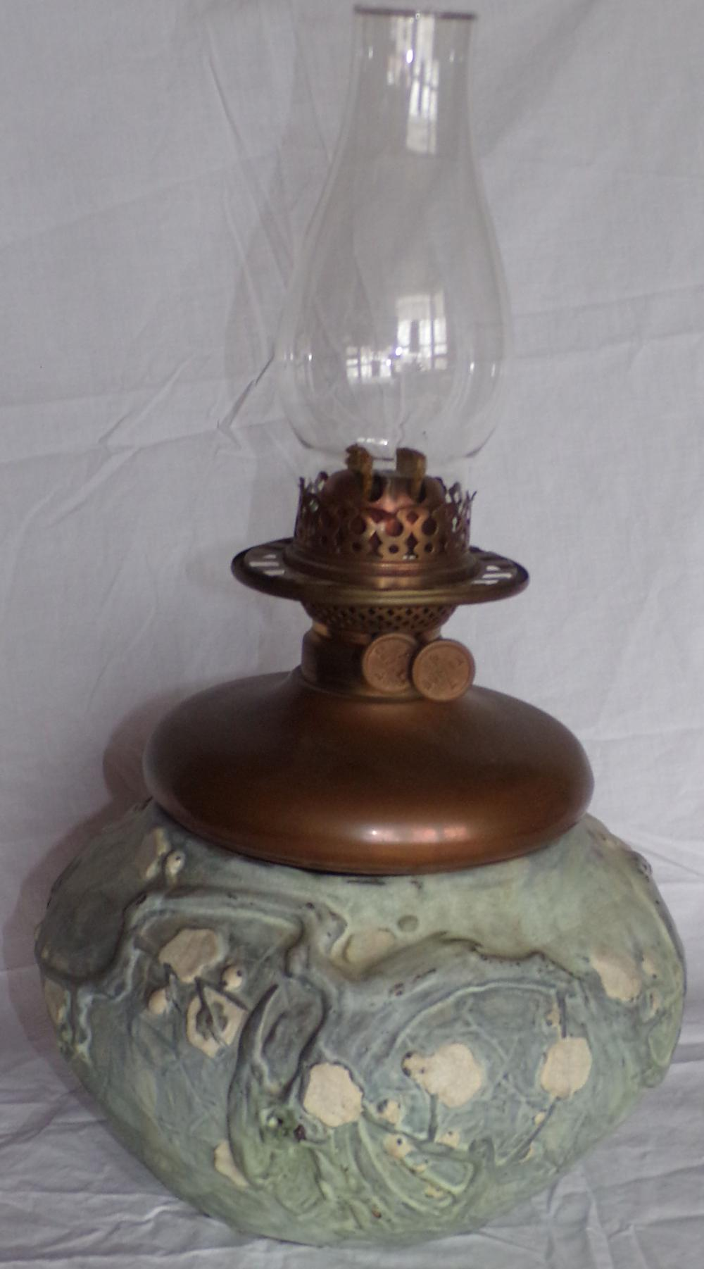 "Vintage Duplex oil lamp having a copper font with glass chimney mounted in an art pottery planter form base, approx. 18"" T(with chimney) x 9 ¾"" diameter"