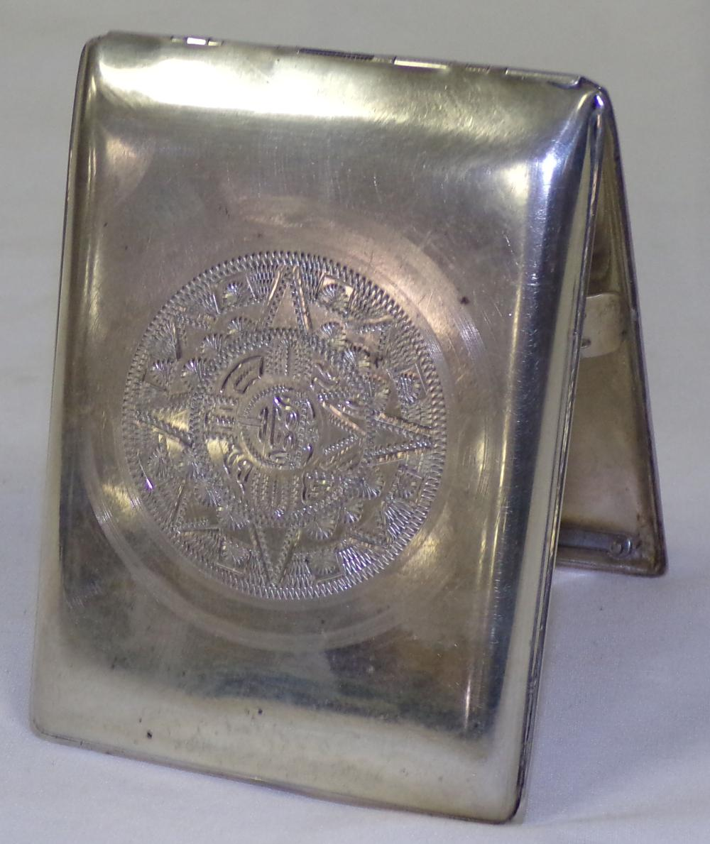 Sterling silver cigarette case, top is engraved with an eight-pointed star design, 3'' W x 4'' D (lid closed)