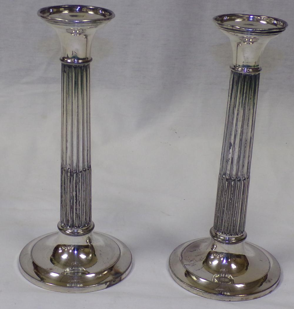 Pair of vintage plated silver column form candle sticks, signed Derby Silver Co., #2567, rounded tops slightly dented, fluted columns, tarnished, each 10 ¼'' T x 4 5/8'' base diameter