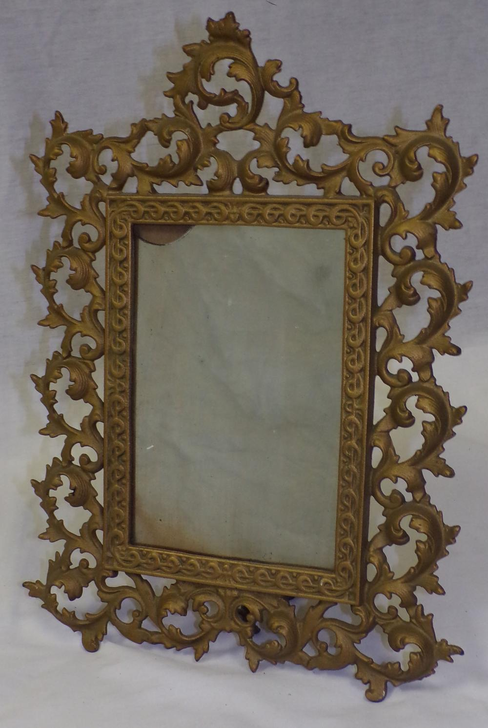 "Ornate iron standing mirror, leaf form design, marked JM32, mirror glass chipped in upper left hand corner,16 ¼ T x 12"" W"